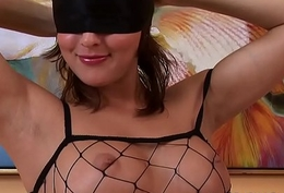 Blindfolded hottie will tease u approximately a banana increased by her fishnet outfit