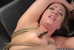 Brunette slave in fetters acquires intense orgasm