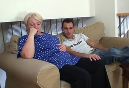 Blonde old granny gives admirer and rides him